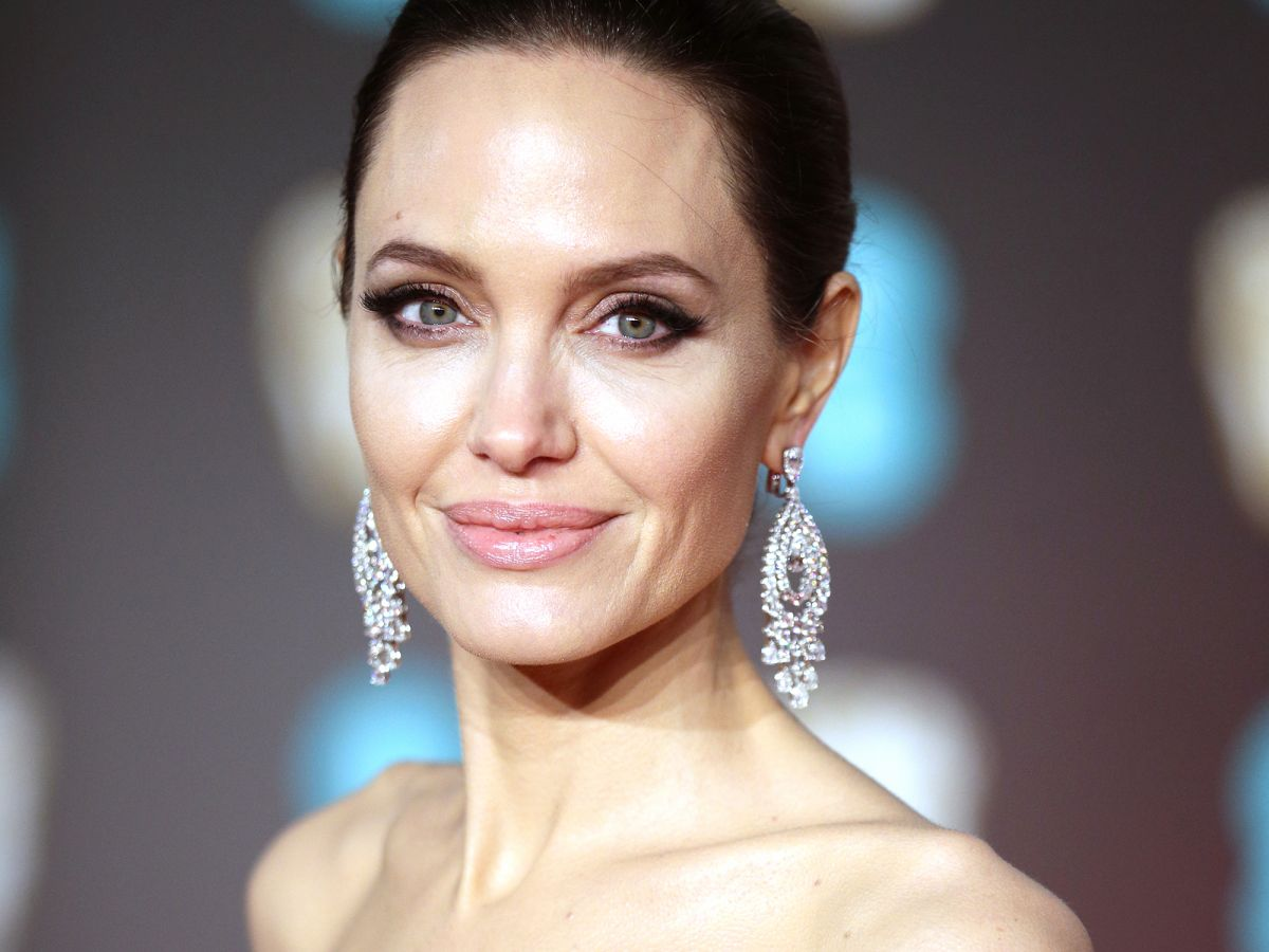 Angelina Jolie's Best Beauty Looks, From '90s Goth To Modern Icon