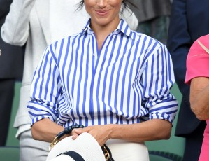 LONDON, ENGLAND - JULY 14: Meghan, Duchess of Sussex attends day twelve of the Wimbledon Tennis Championships at the All England Lawn Tennis and Croquet Club on July 14, 2018 in London, England. (Photo by Karwai Tang/WireImage )