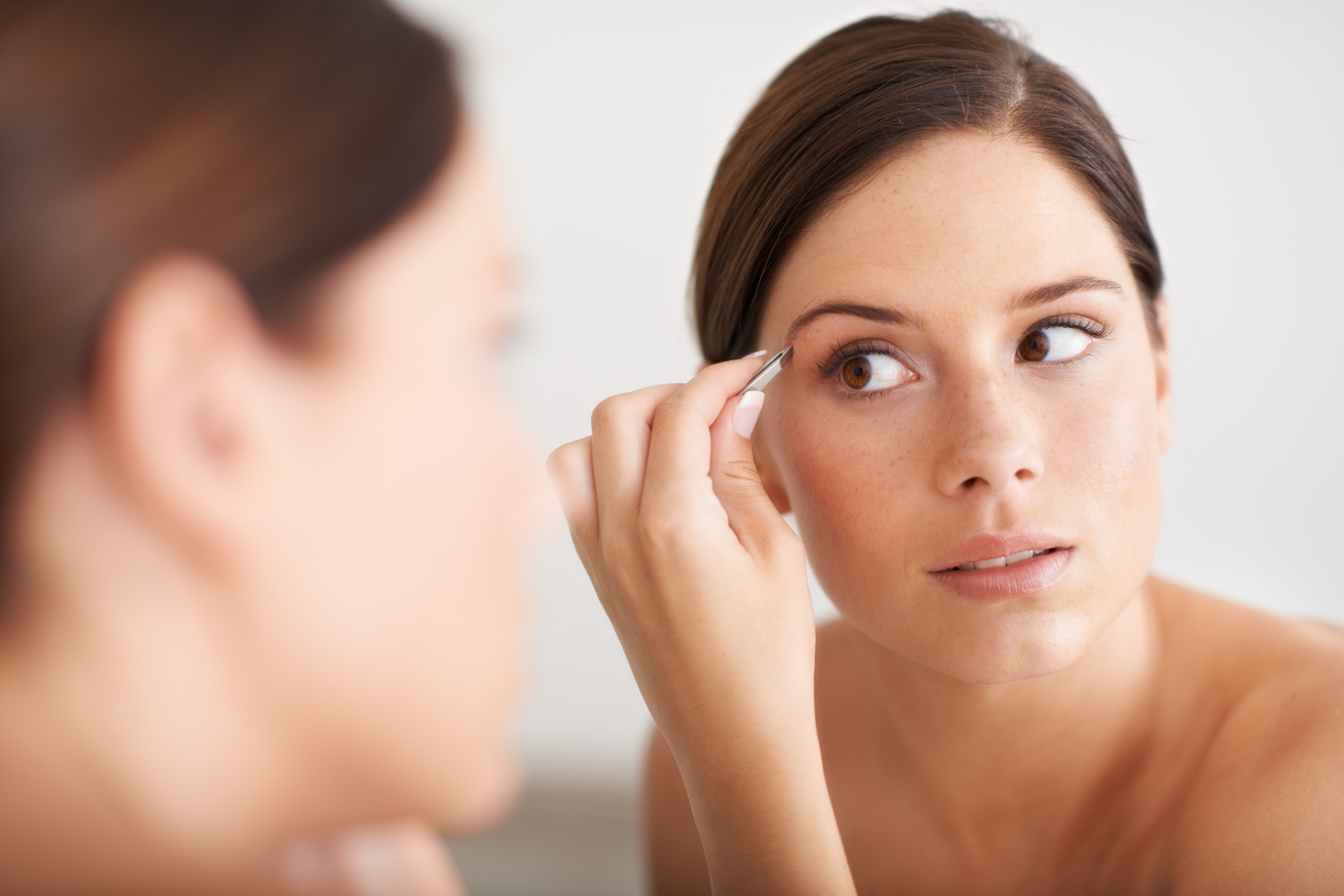 The One Thing You Should Never Do When Tweezing Your Brows