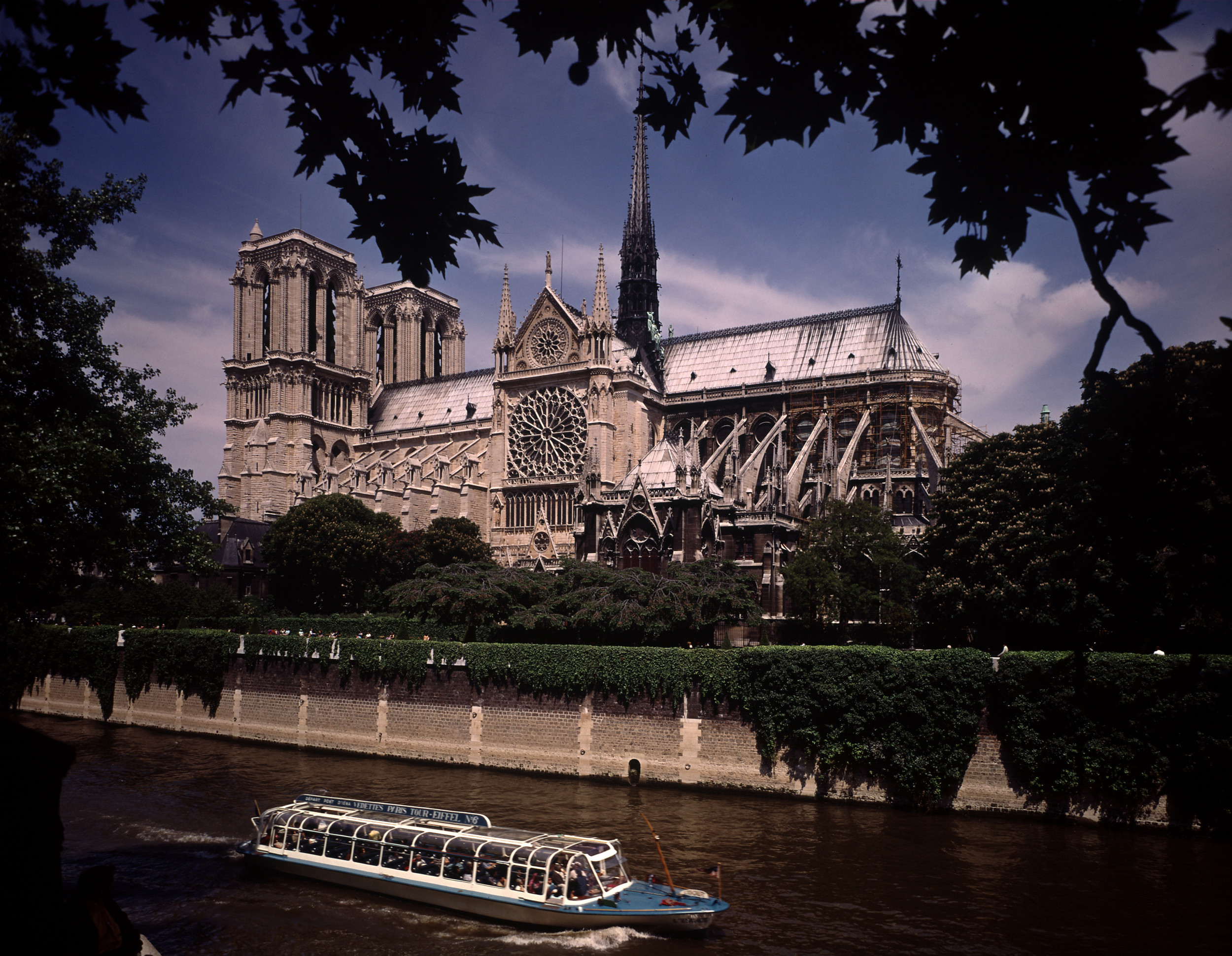 FRANCE - 1970: Notre Dame Cathedral as seen from the Seine with sightseeing boat going by. (Photo by Bill Ray/Life Magazine/The LIFE Picture Collection/Getty Images)