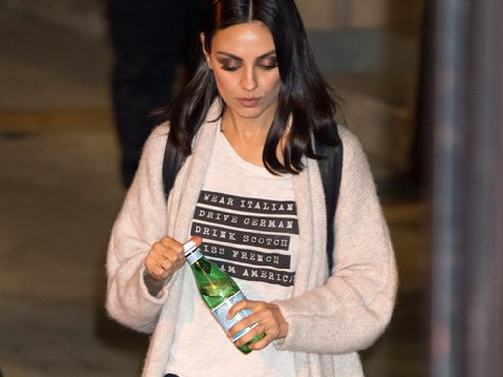 Is Mila Kunis Trying to Send Us a Message Through Her Outfits?